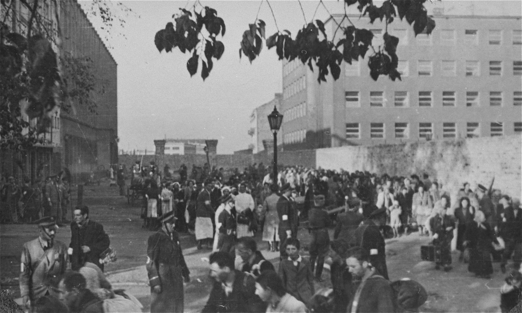 Jews are assembled for deportation at the Umschlagplatz in the Warsaw ghetto.