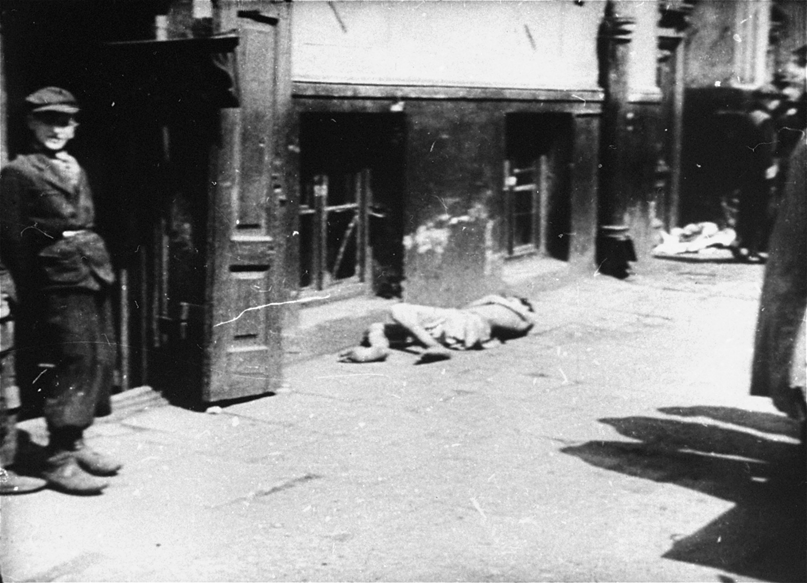A body on the street in the Warsaw ghetto.