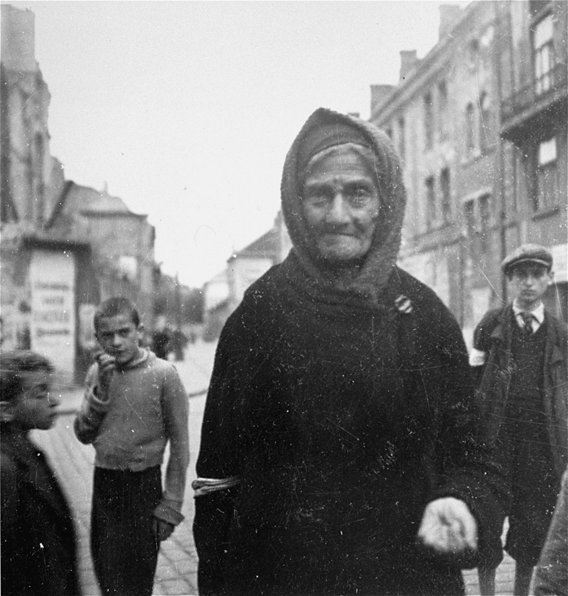"An elderly woman begs on the street in the Warsaw ghetto.  Joest's caption reads: ""I believe this was the only time that a begging woman held out her hand to me.  Where [in the ghetto] it was I do not know."""
