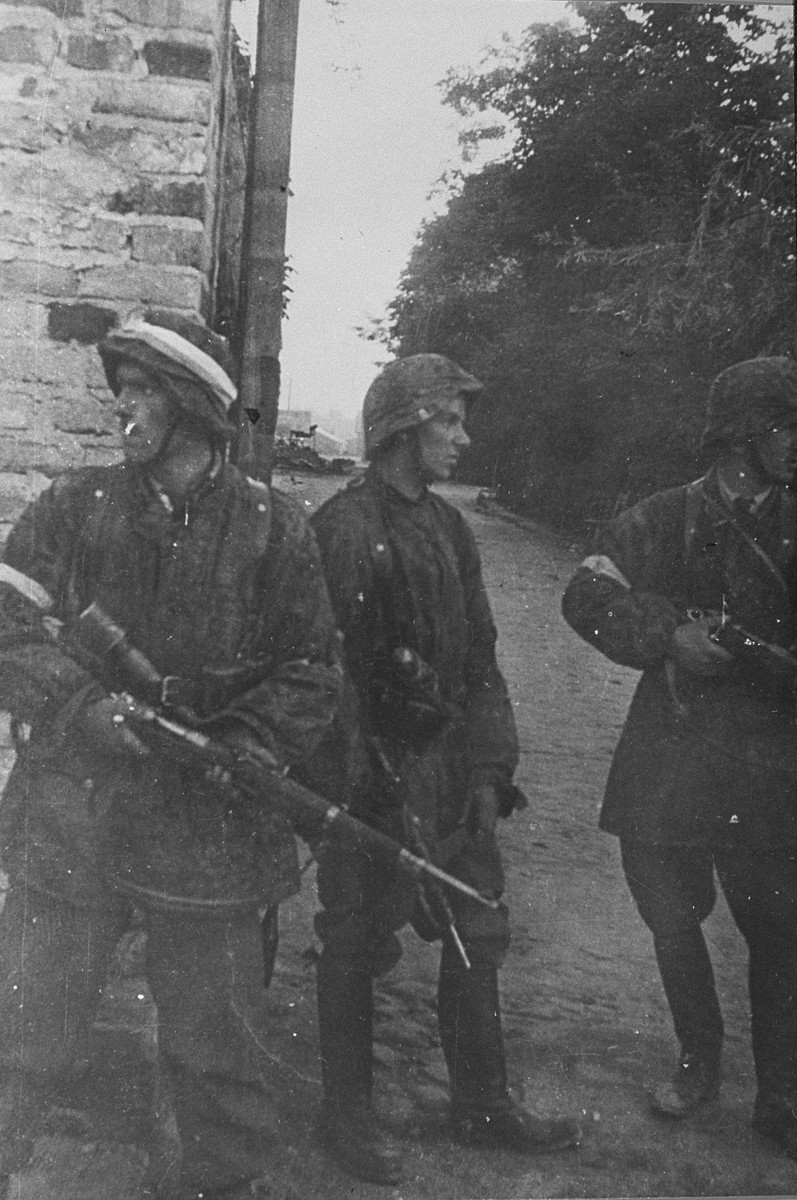 Members of the Zoska battalion of the Armia Krajowa in action during the 1944 Polish resistance uprising.    The men are dressed in stolen German uniforms and armed with confiscated German weapons.  Pictured from left to right are Wojciech Omyla, Juliusz Bogdan Deczkowski (the donor), and Tadeusz Milewski.  Milewski was killed shortly thereafter.  Omyla was killed several days later on August 8, 1944.  The Zoska battalion liberated 348 Jews from the Gesiowka prison during the uprising.