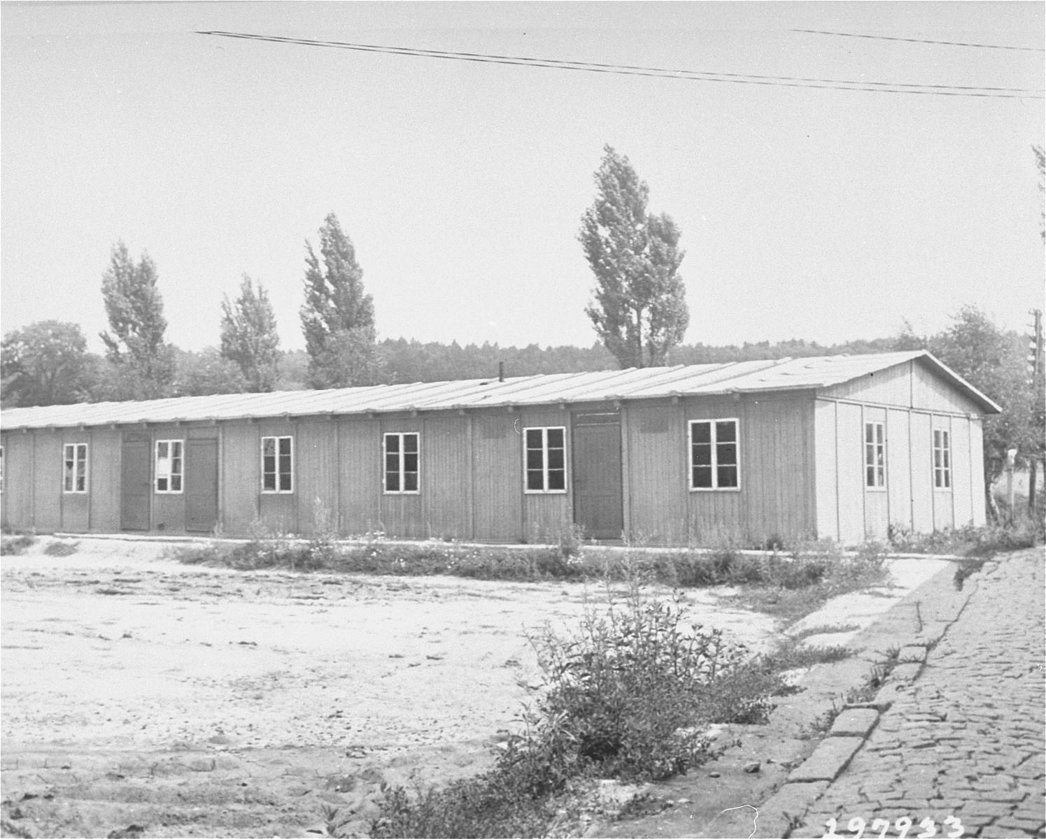 Exterior view of a school building in the Ebelsberg displaced persons' camp which had formerly been a recreation center for American personnel.