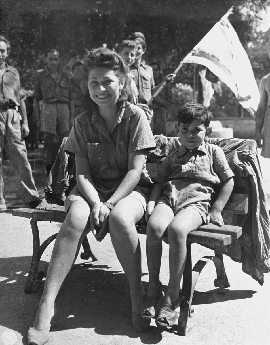 Stella Aojne, a former nurse with the Yugoslav Partisan Army, and her son, Ivol, await transportation to the port of Naples, where they will board a ship to Palestine.   Stella's husband was killed while fighting with the Partisans.