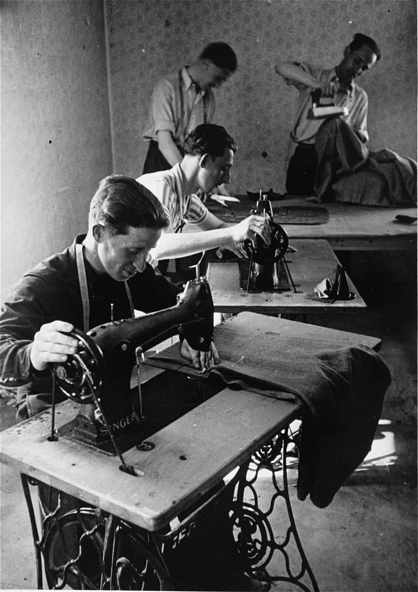 Jewish men working in a sewing workshop in the Bindermichl DP camp.