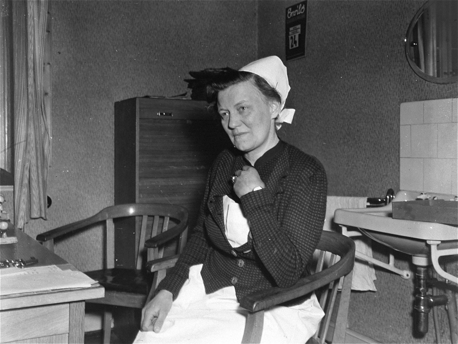 Portrait of Irmgard Huber, chief nurse at the Hadamar Institute, in her office.  The photograph was taken by an American military photographer soon after the liberation.