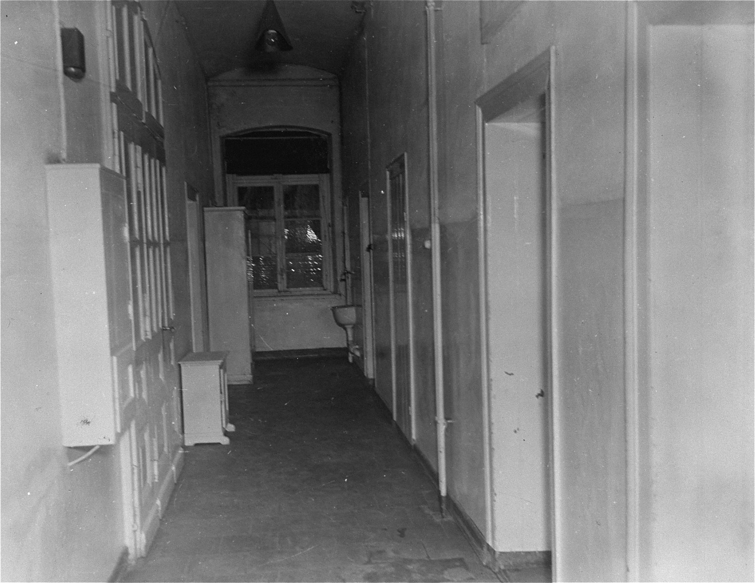 "View of a corridor at the Hadamar Institute called ""Death Row"".   Victims in rooms leading off this corridor were marked for immediate death. The photograph was taken by an American military photographer soon after the liberation."