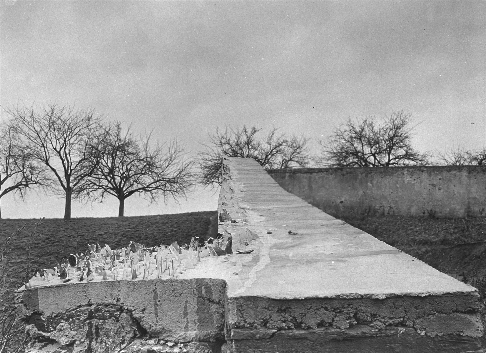 View of the wall surrounding the cemetery of the Hadamar Institute on which jagged pieces of glass were placed to discourage observers.  The photograph was taken by an American military photographer soon after the liberation.