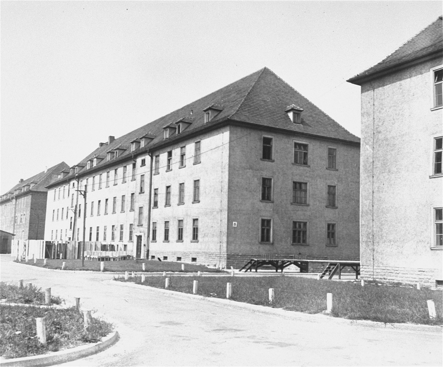 Exterior view of a barrack in Ebelsberg DP camp.  The camp was formerly used for American military personnel.