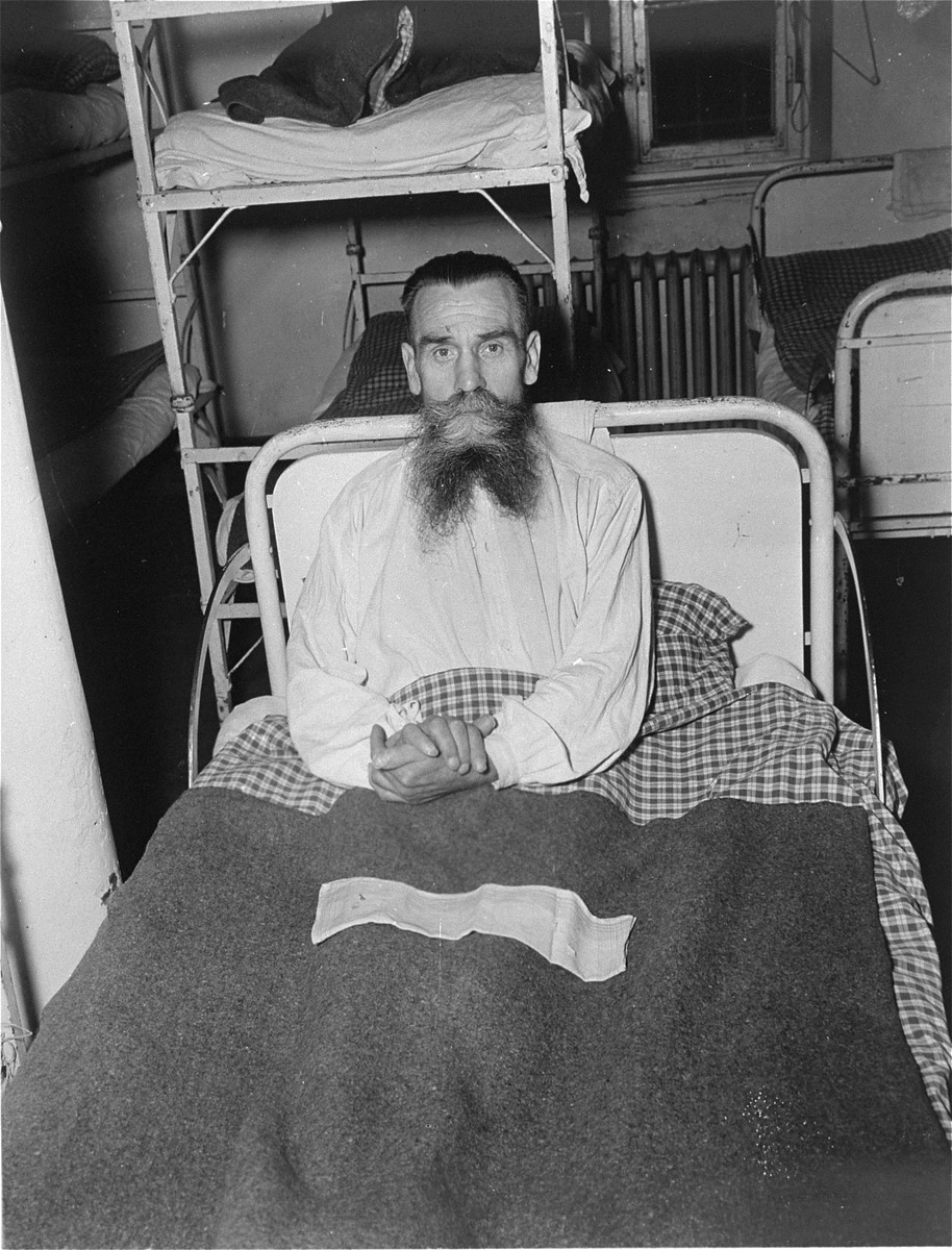A half-starved survivor sits up in bed at the Hadamar Institute.  The photograph was taken by an American military photographer soon after the liberation.