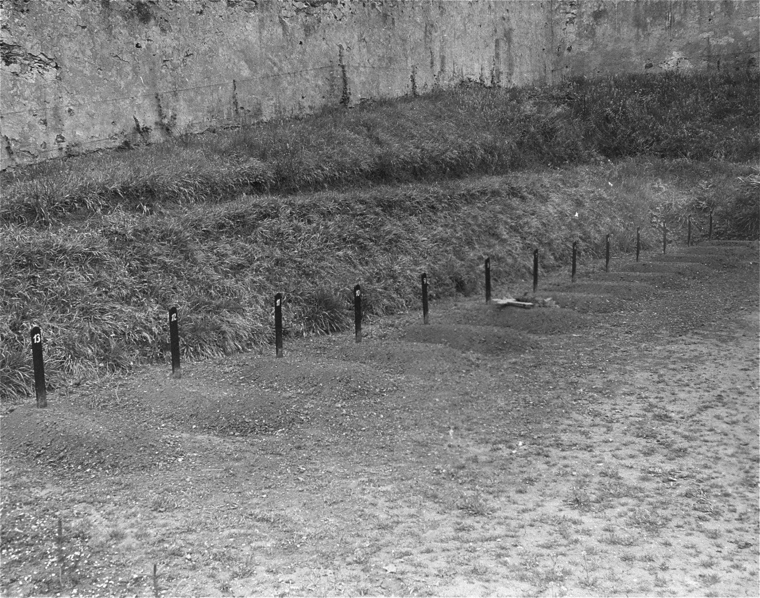 View of the cemetery at the Hadamar Institute showing thirteen graves of children murdered at the euthanasia facility.    This plot was separate from the main graveyard.  The photograph was taken by an American military photographer soon after the liberation.