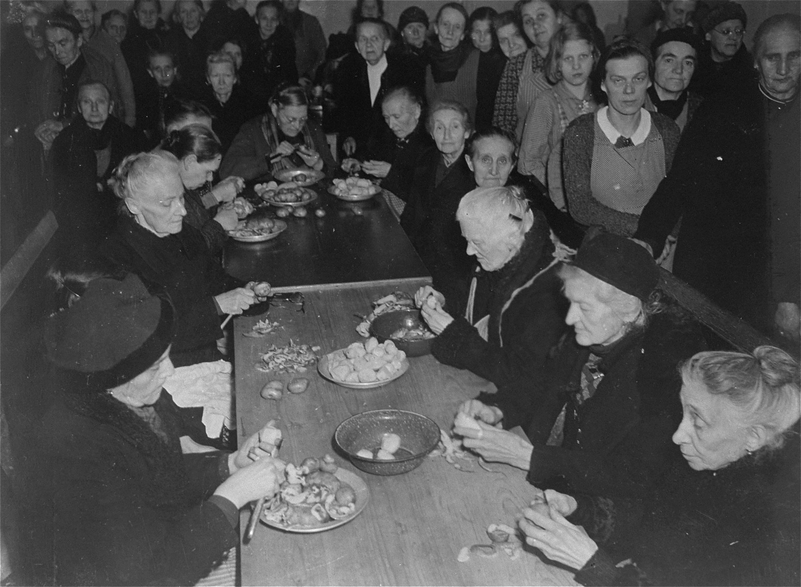 A group of elderly survivors preparing food at the Hadamar Institute.   The photograph was taken by an American military photographer soon after the liberation.