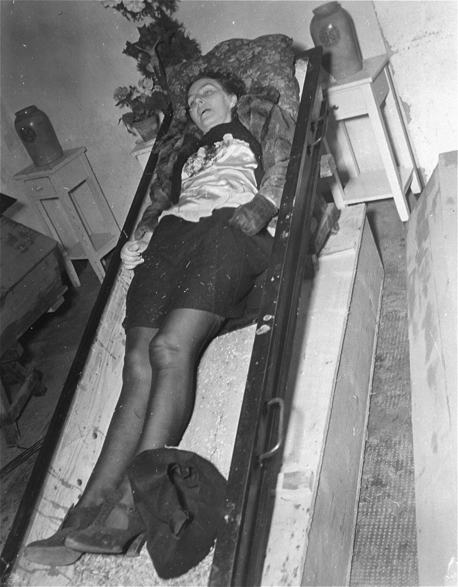 The corpse of a woman lies in an open coffin at the Hadamar Institute where she was put to death as part of the Operation T4 euthanasia program.  The photograph was taken by an American military photographer soon after the liberation.