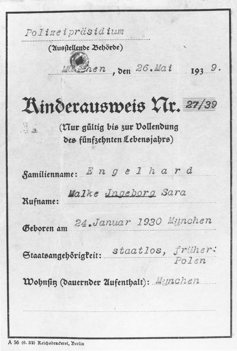 "Children's identification card issued by the German police to Inge Engelhard, in which she has been given the middle name of ""Sara"" and declared stateless.  This card was used in lieu of a passport when Inge entered England on a Kindertransport and was stamped by immigration authorities in Harwich."