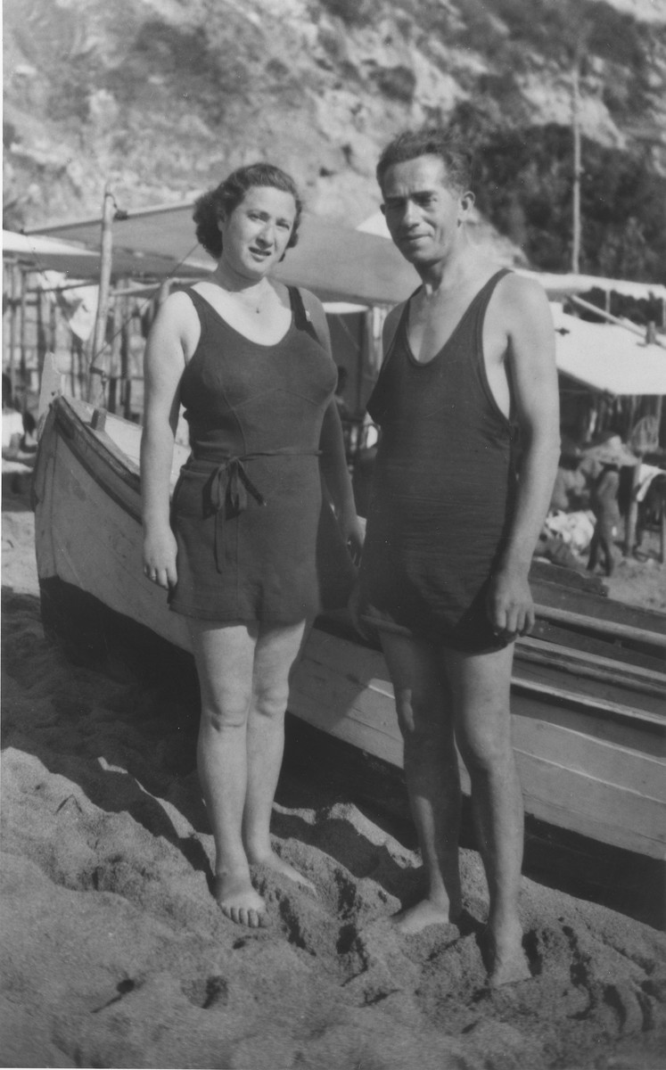 Portrait of German Jewish refugees, Moshe and Rachel Engelhard, at a beach in Portugal, while waiting to join their children in England.