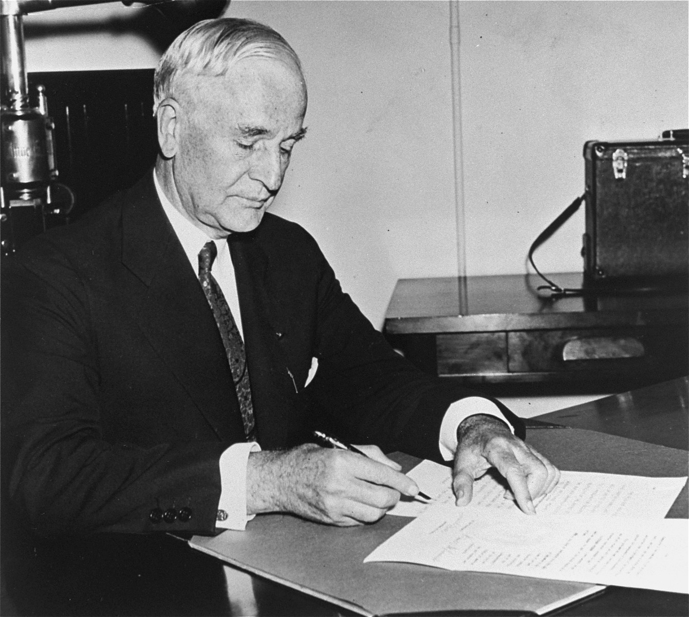 Portrait of Secretary of State Cordell Hull signing the president's Neutrality Proclamation.