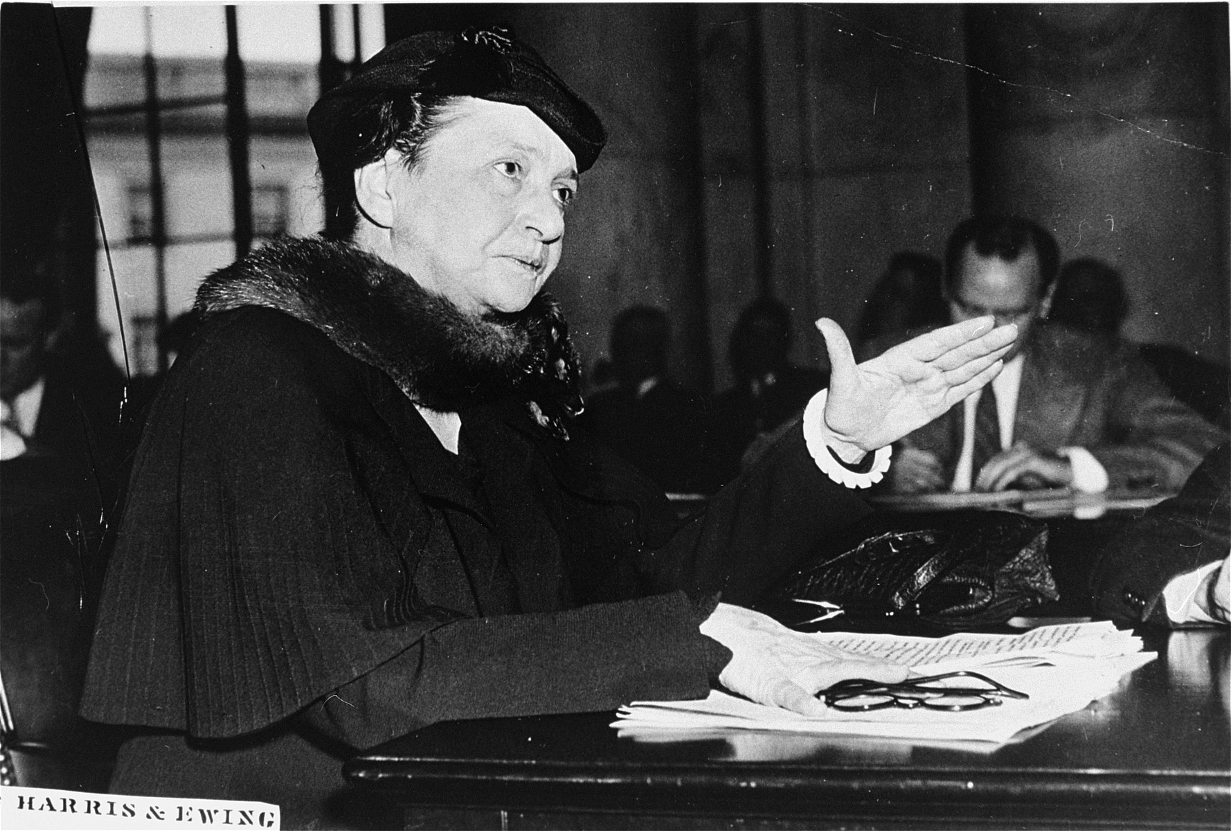 Portrait of Secretary of Labor Frances Perkins testifying before a Senate committee hearing on low income housing subsidies.
