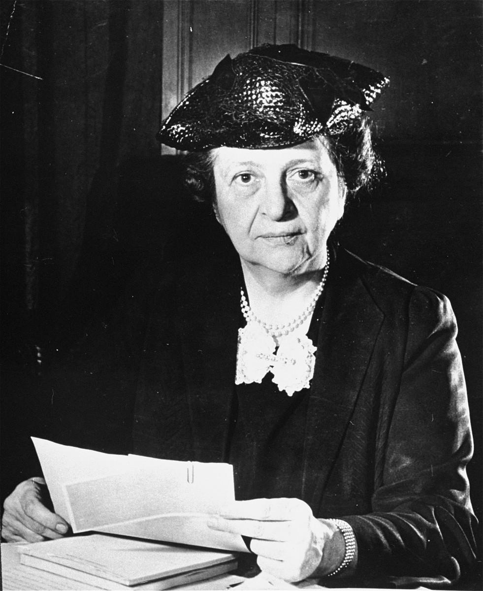 Portrait of Secretary of Labor Frances Perkins at her desk.