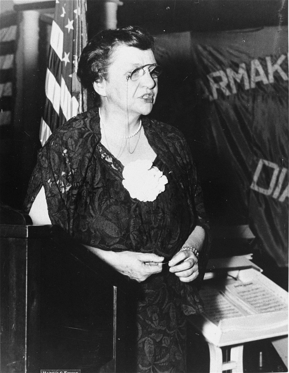 Portrait of Secretary of Labor Frances Perkins delivering a speech at the gala celebration of the 75th anniversary of the International Cigar Makers Union at the Raleigh hotel in Washington.
