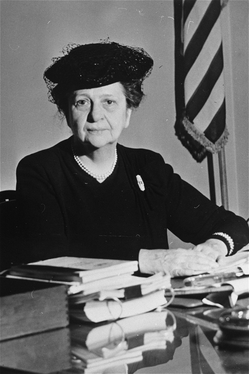 Portrait of Frances Perkins sitting at her desk.  Frances Perkins (1882-1965). As President , Roosevelt appointed her U.S. Secretary of Labor--the first appointment of a woman to the U.S. cabinet.  Her appointment was bitterly criticized by business, political and labor leaders. As Secretary of Labor she promoted adoption of the Social Security Act, advocated higher wages and helped standardize state industrial legislation. After she resigned, she served from (1946-52) as a member of the U.S. Civil Service Commission.
