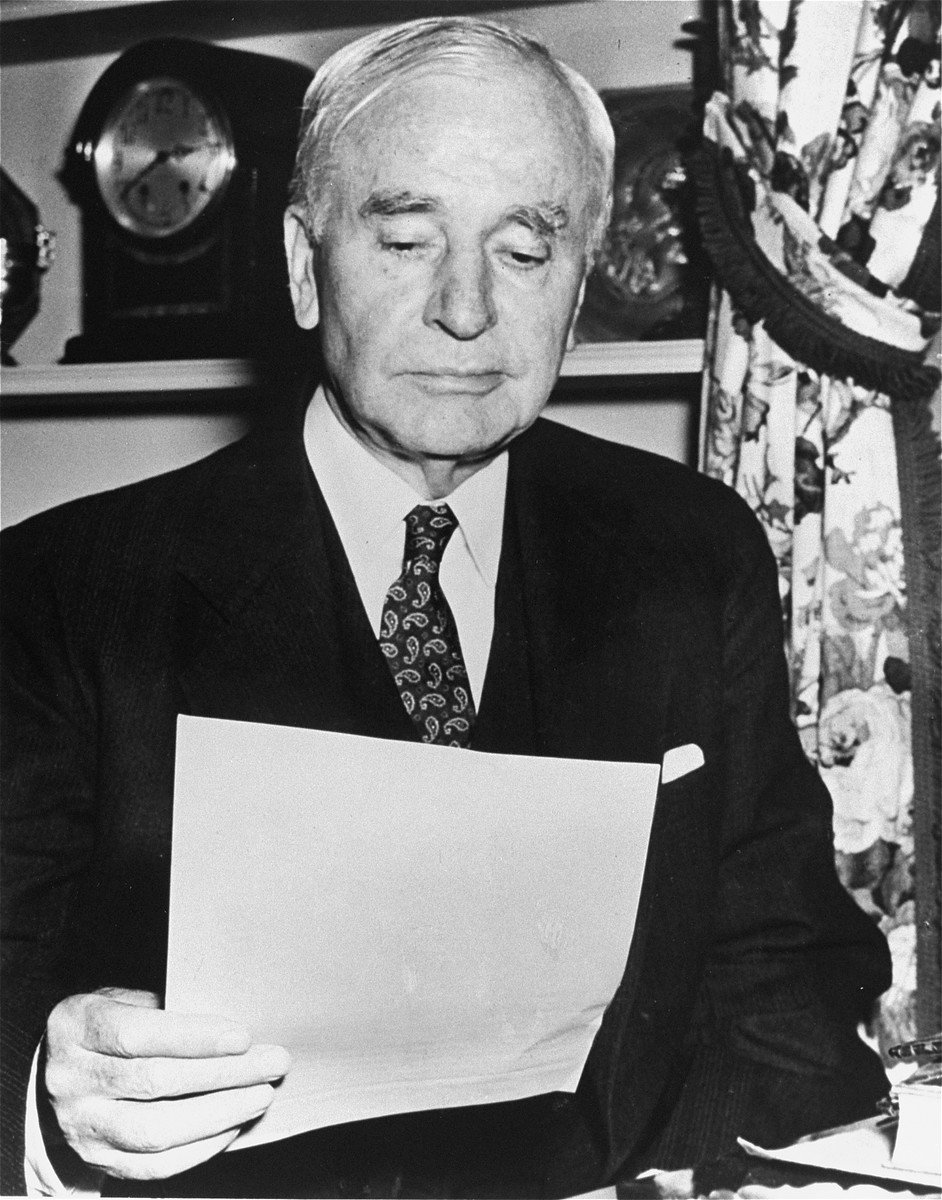 Portrait of Cordell Hull reading a document.