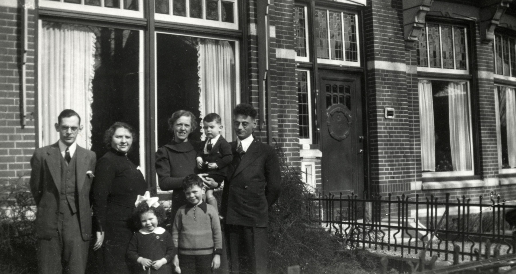 The Drukker family poses outside its home in Winschoten.  Pictured in front are Elly and Alfred Drukker.  Behind them from lef tto right are unidentified, Erna Drukker,  Stein holding a child and Maurits Drukker.