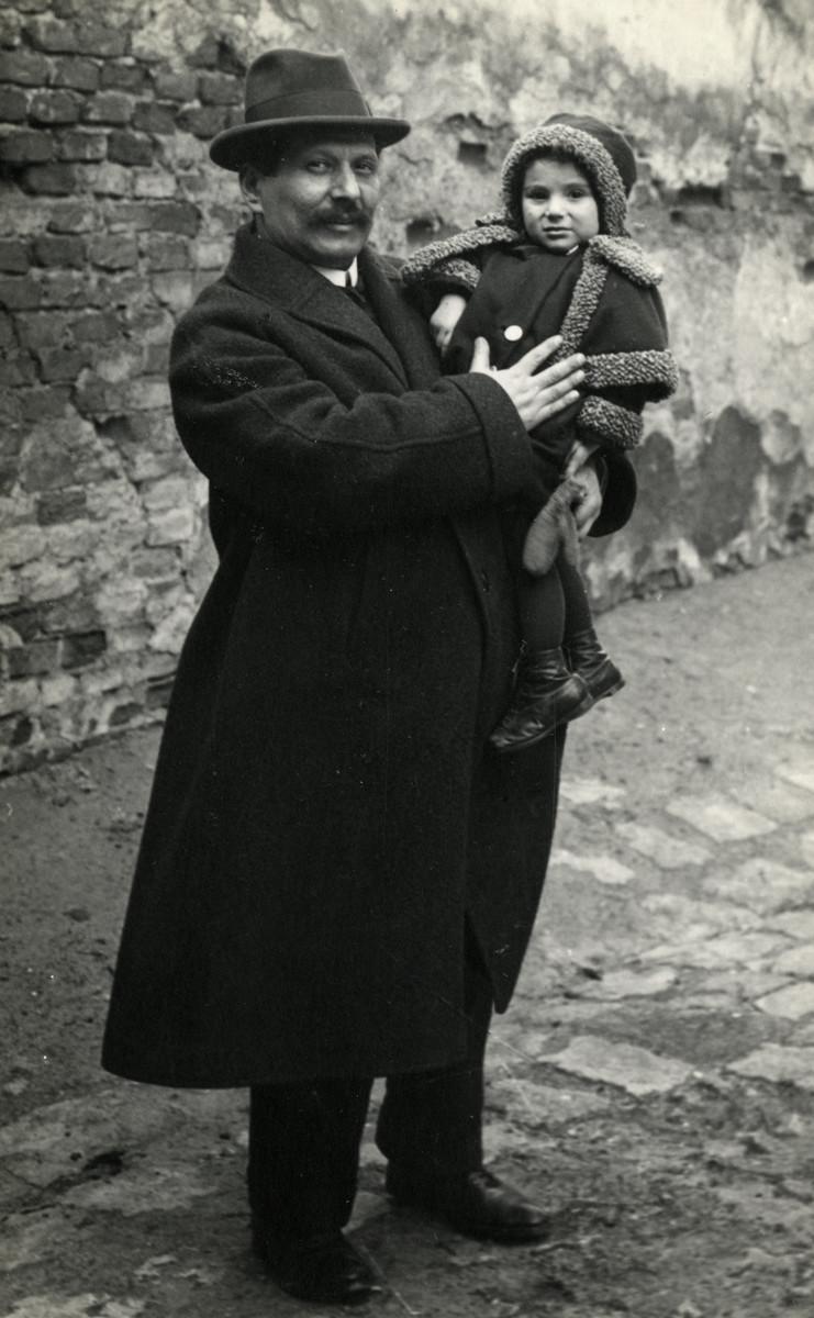 Wilhelm Steiner holds his baby daughter Reline.