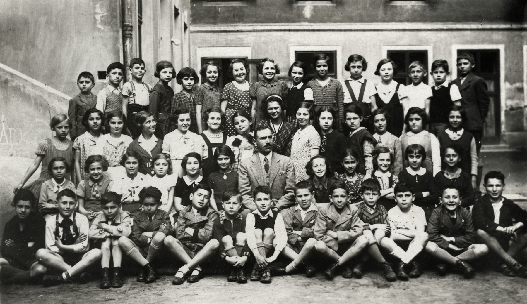 Group portrait of the children in the Nelog Jewish school in Bratislava.  David Zigmund Steiner is pictured 6th from the right on the bottom row.