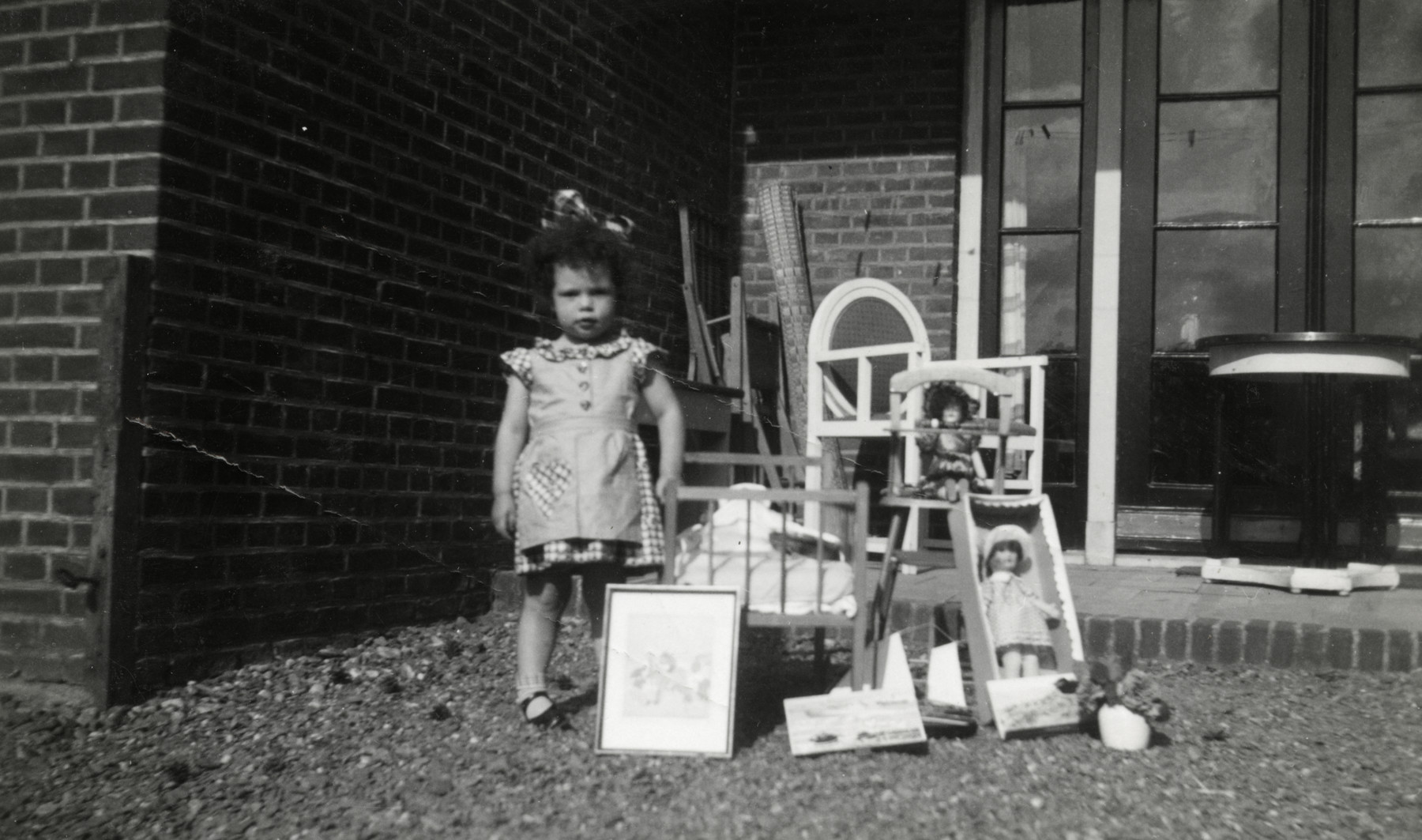 Three-year-old Elly Drukker poses with her toys,