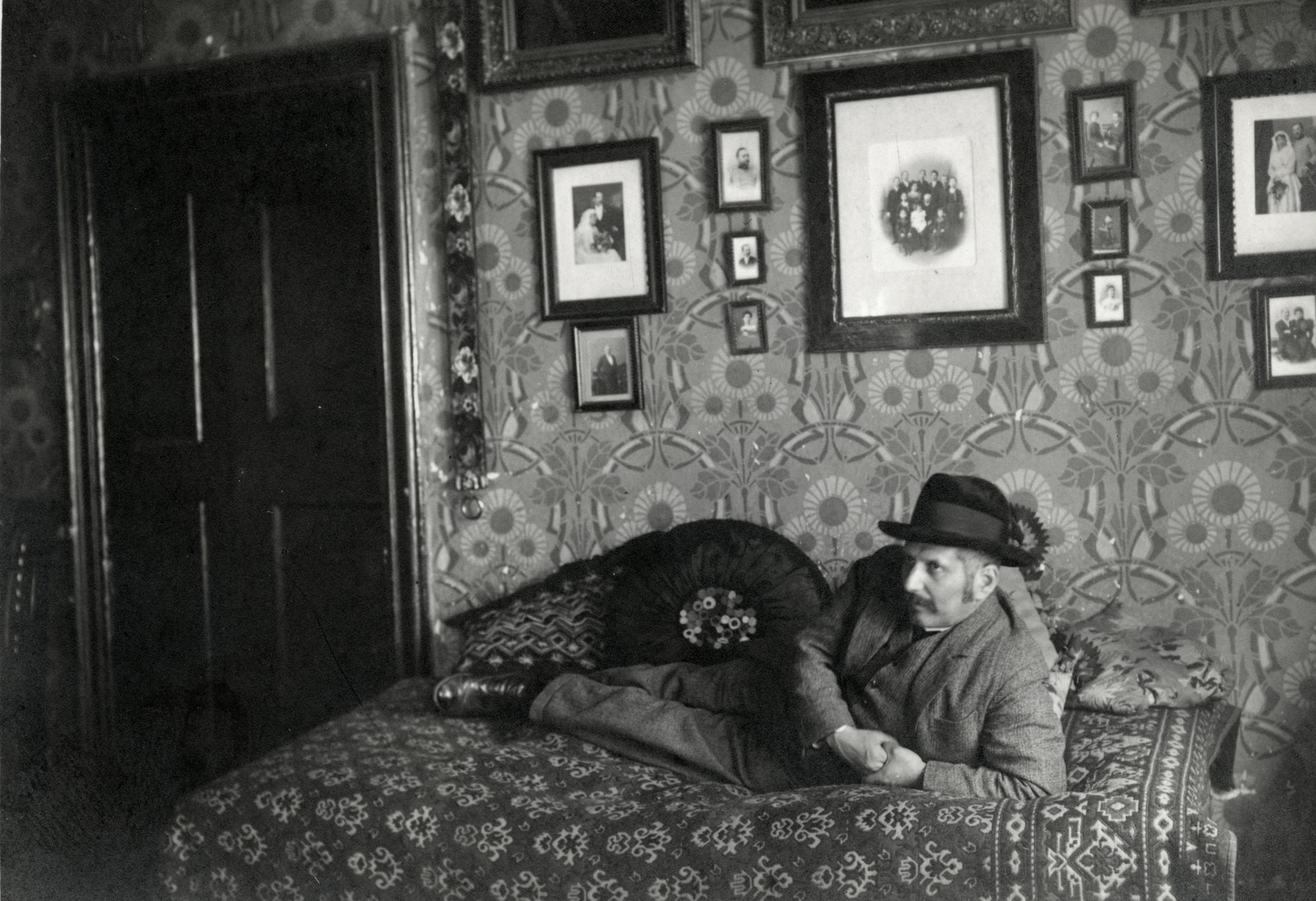 Wilhelm Steiner poses on the bed in his apartment in prewar Bratislava.