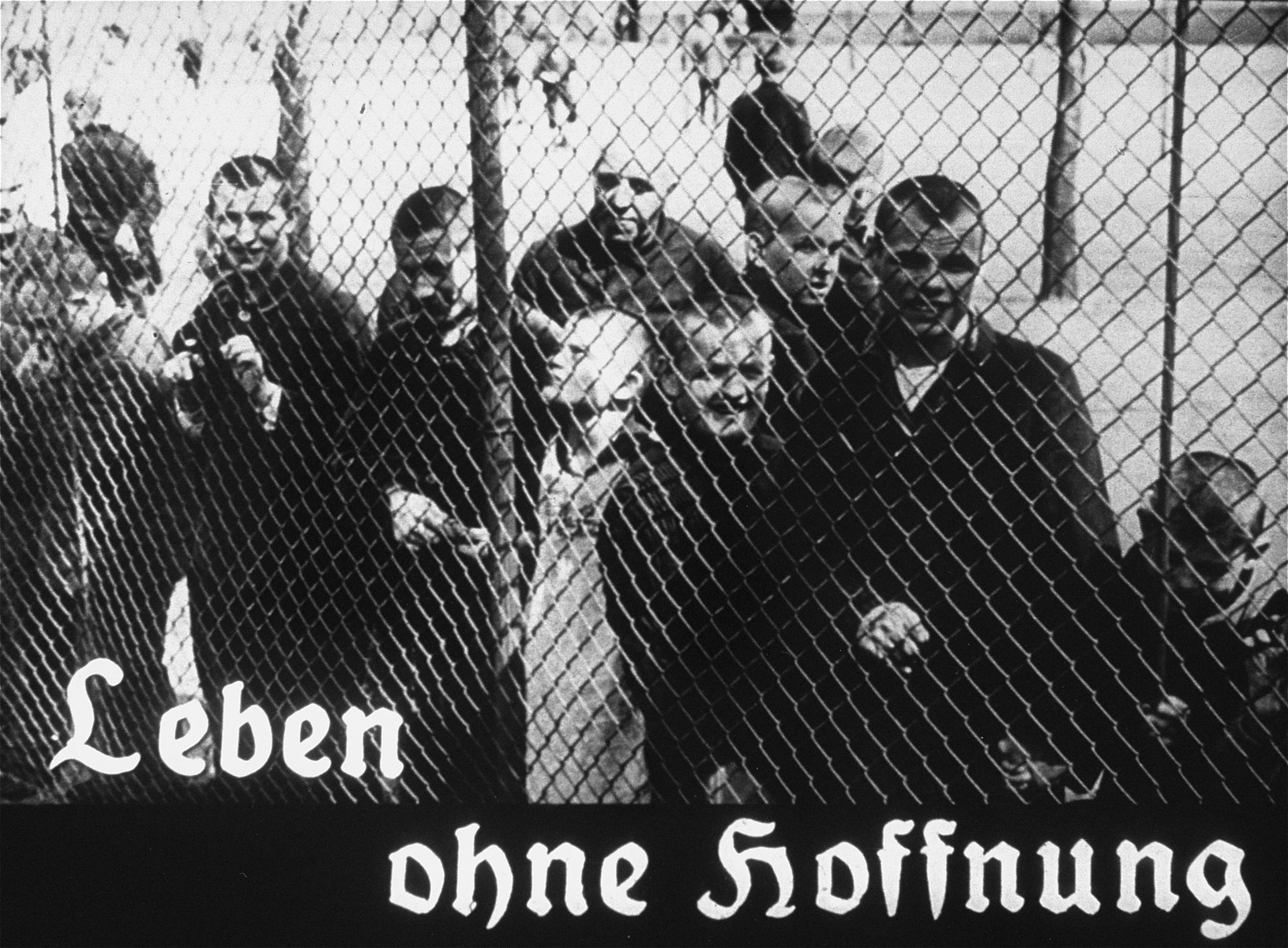 "Propaganda slide featuring mentally ill patients behind a fence in an unidentified asylum.  The caption reads, ""Life without hope."""