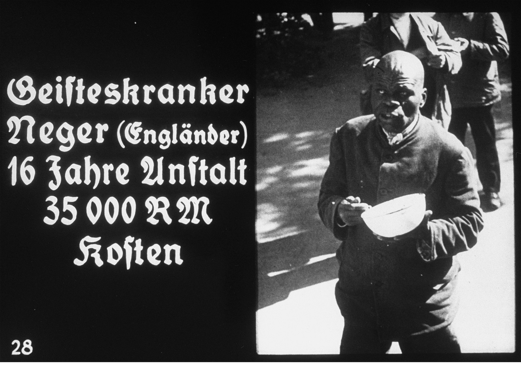 """Propaganda slide featuring a mentally ill British Black man in an unidentified asylum.    The caption reads: """"Mentally ill Negro (British)/16 years of care/costs 35,000 RM."""