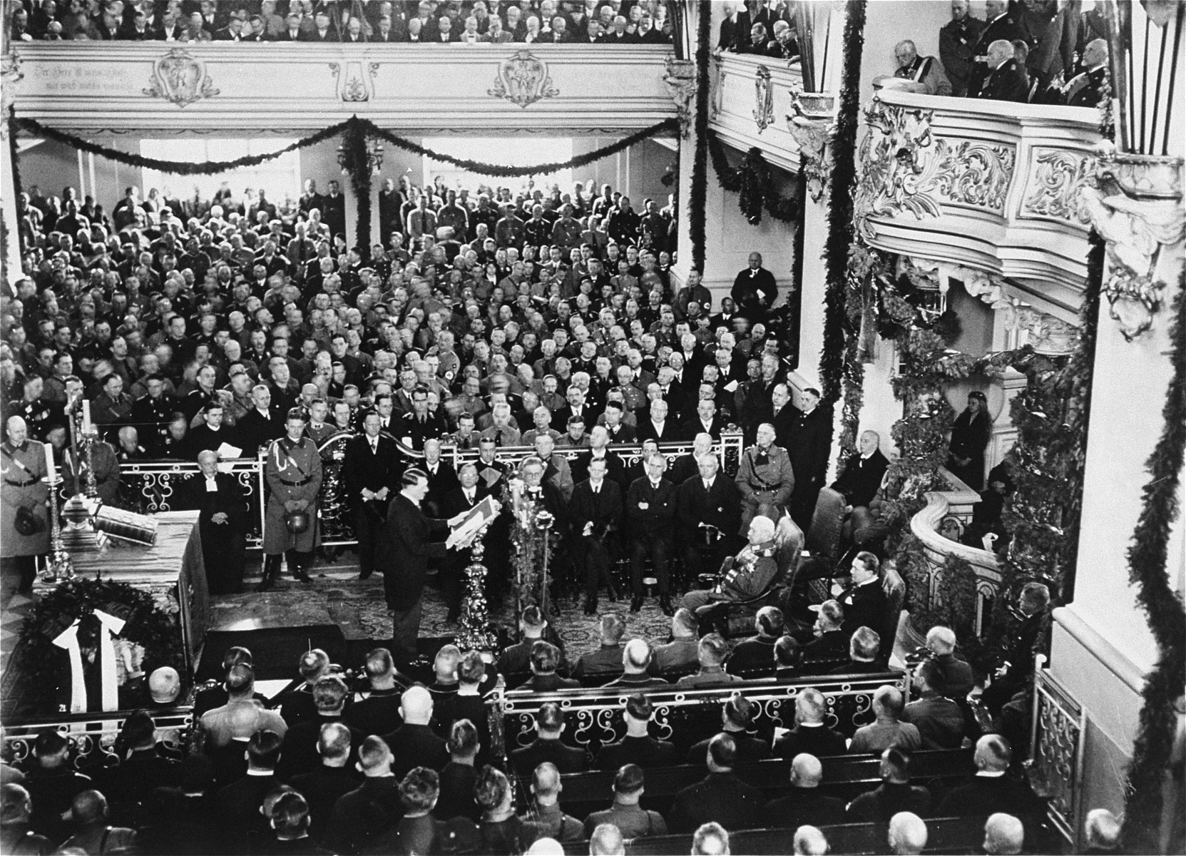 Hitler delivers his first address at the opening of the new Reichstag in Potsdam.