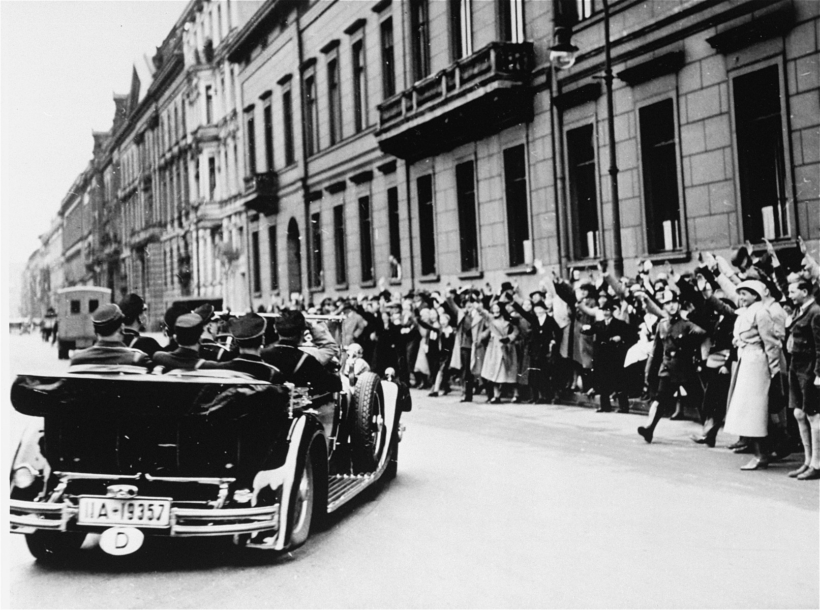 Cheering Berliners greet Adolf Hitler in front of the chancellery as he travels to the Kroll Opera House for the opening of the first working session of the Reichstag two days after the ceremonial opening in Potsdam.