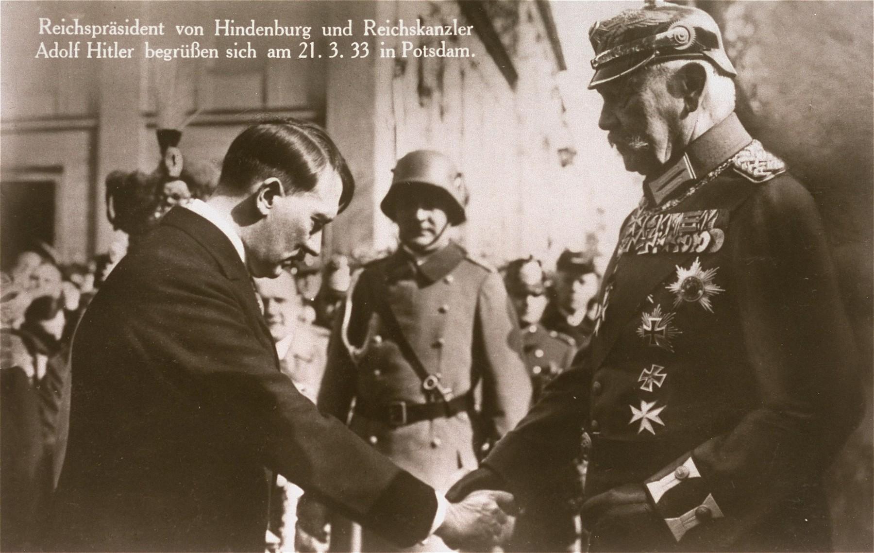 German chancellor Adolf Hitler greets President Paul von Hindenburg during opening ceremonies for the new Reichstag in Potsdam.