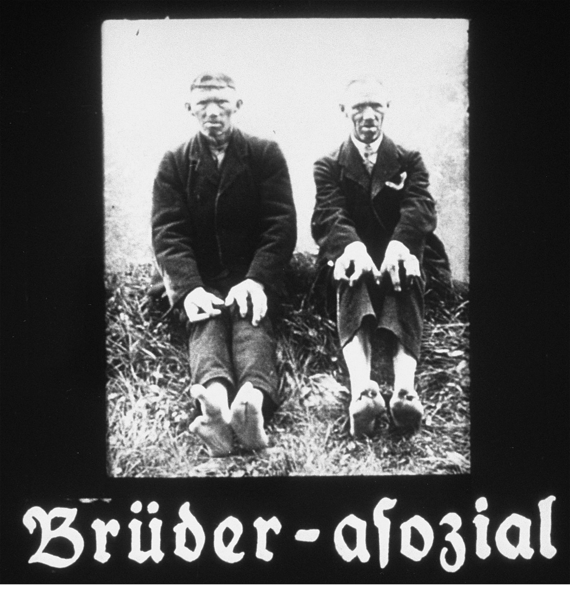 """Propaganda slide featuring two disabled brothers sitting in the grass.  The caption reads, """"Brothers-asocial."""""""