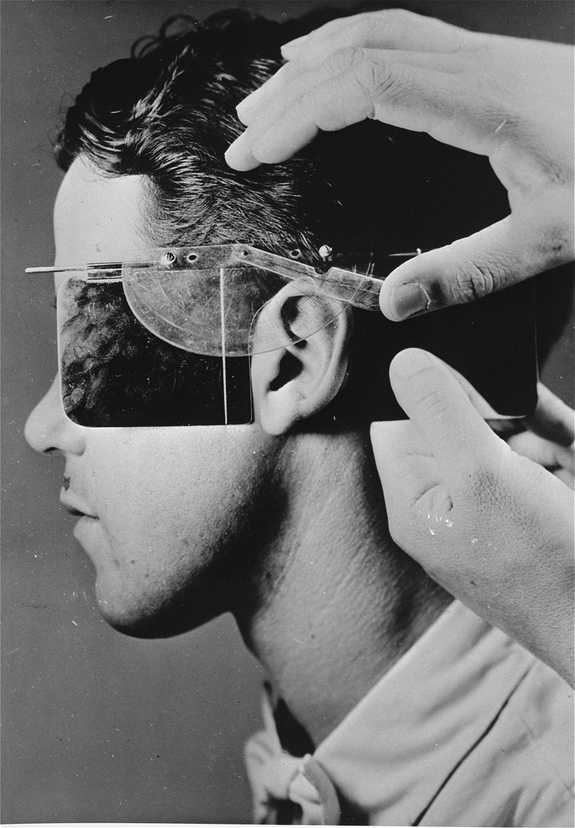 The facial features of a young German are measured during a racial examination at the Kaiser Wilhelm Institute for Anthropology.