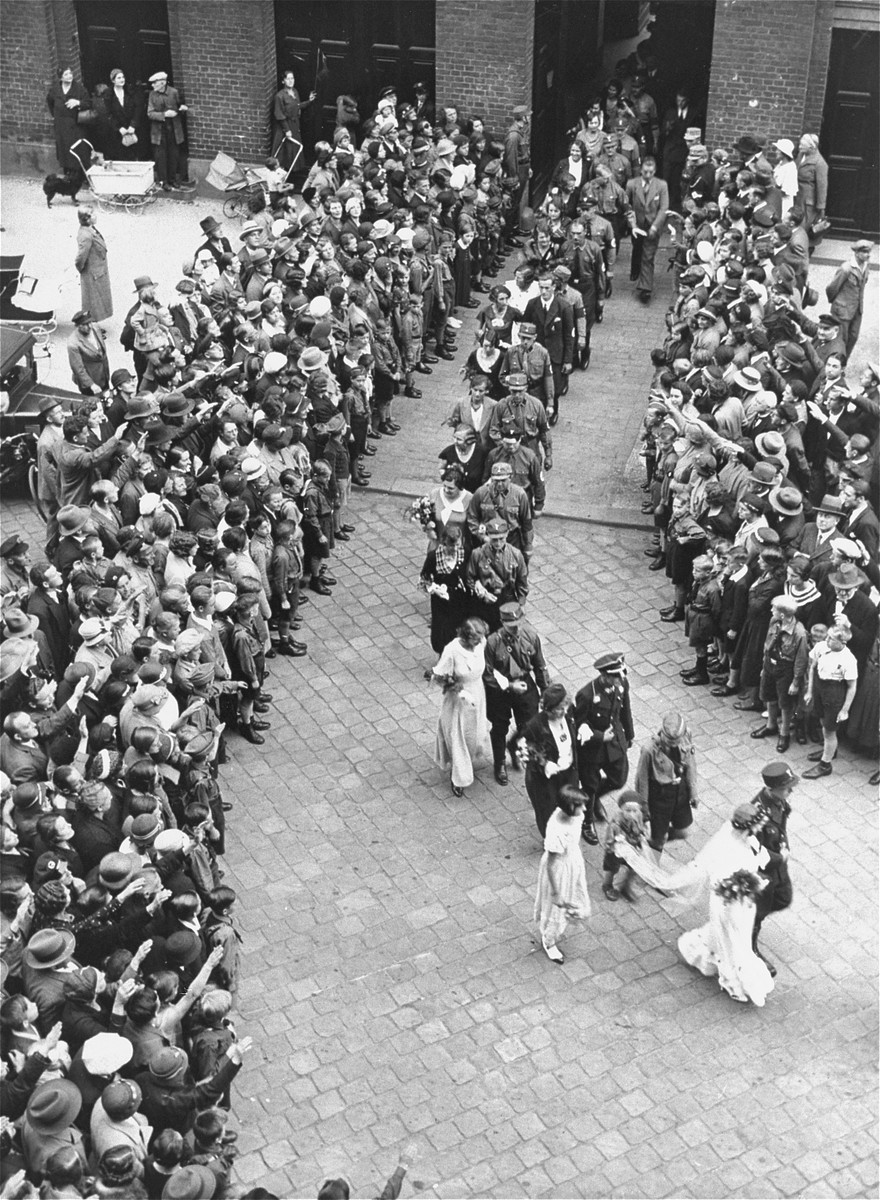 A mass marriage of 50 bridal pairs in Berlin.  All of the couples belonged to the NSDAP.