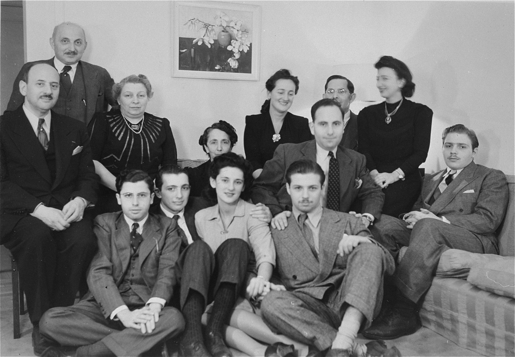 Group portrait of a family of Belgian Jewish refugees who found safe haven in the US during World War II.  Among those pictured are: Joseph and Deborah Friedmann (top row, left); William Friedman and Helene Ginsburg (front row, right); and Margot Soldinger, (Helene's sister, standing in the middle).