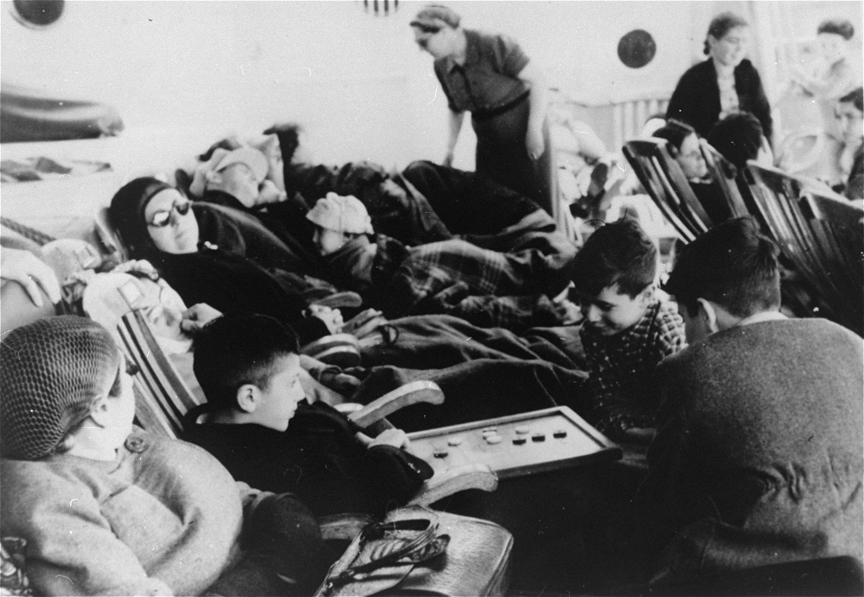 German Jewish refugees relax on the deck of the SS Iberia during the voyage from Lisbon to Havana.    Among those pictured are Manfred and Klaus Gallewski.