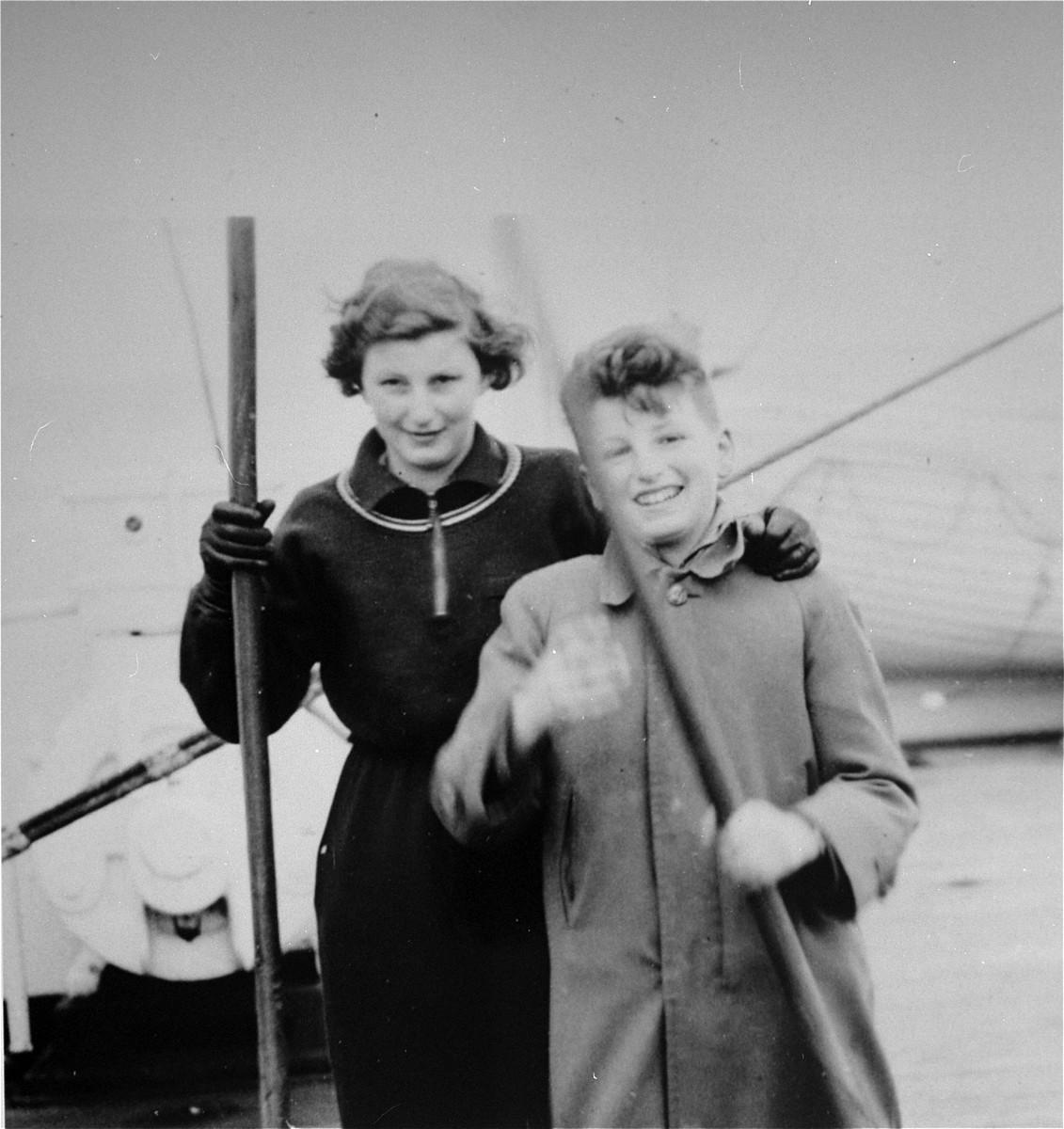 Two Jewish refugee siblings from Vienna pose on board the SS Pennland of the Holland-America Line, while en route to the U.S.  Pictured are Peter and Eva Kollisch.