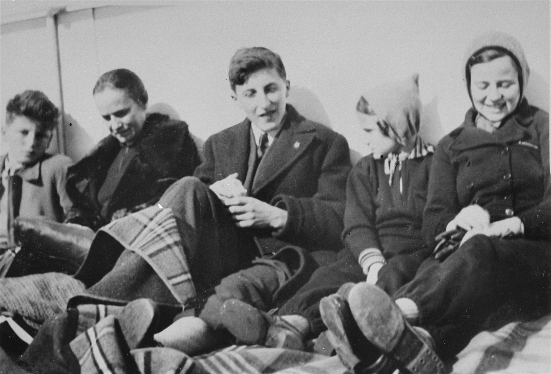 Jewish refugee children sit on the deck of the SS Pennland of the Holland-America line while en route to the U.S.   Among those pictured are: Peter (far left) and Stephen (center) Kollisch from Vienna.