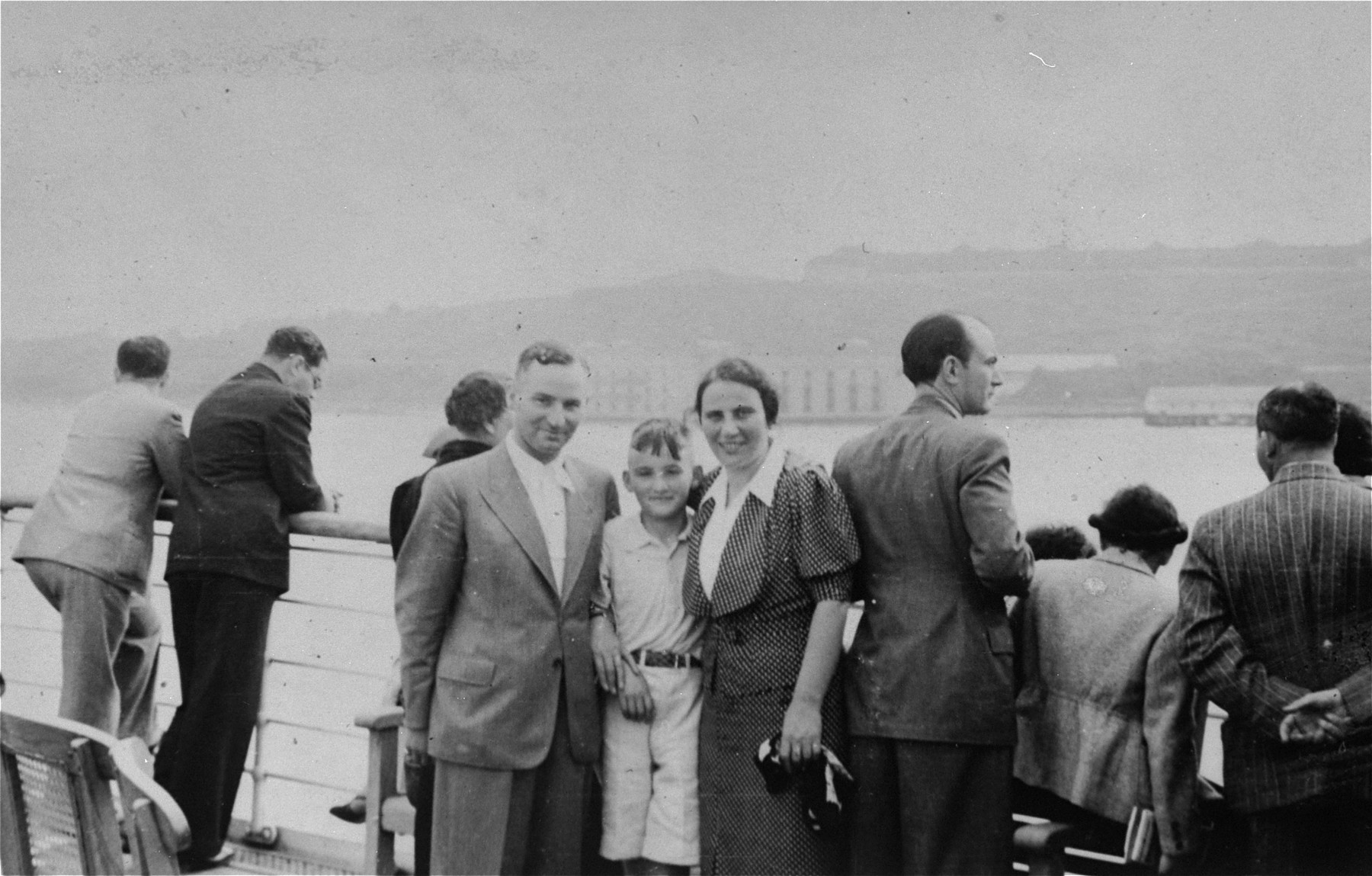 A Jewish refugee family from Germany poses for a picture as their ship, the SS Rotterdam, arrives in New York harbor.  Pictured are Sol and Henrietta Meyer and their son Harvey.  (The Meyers are the aunt and uncle of donor Jill Pauly.)