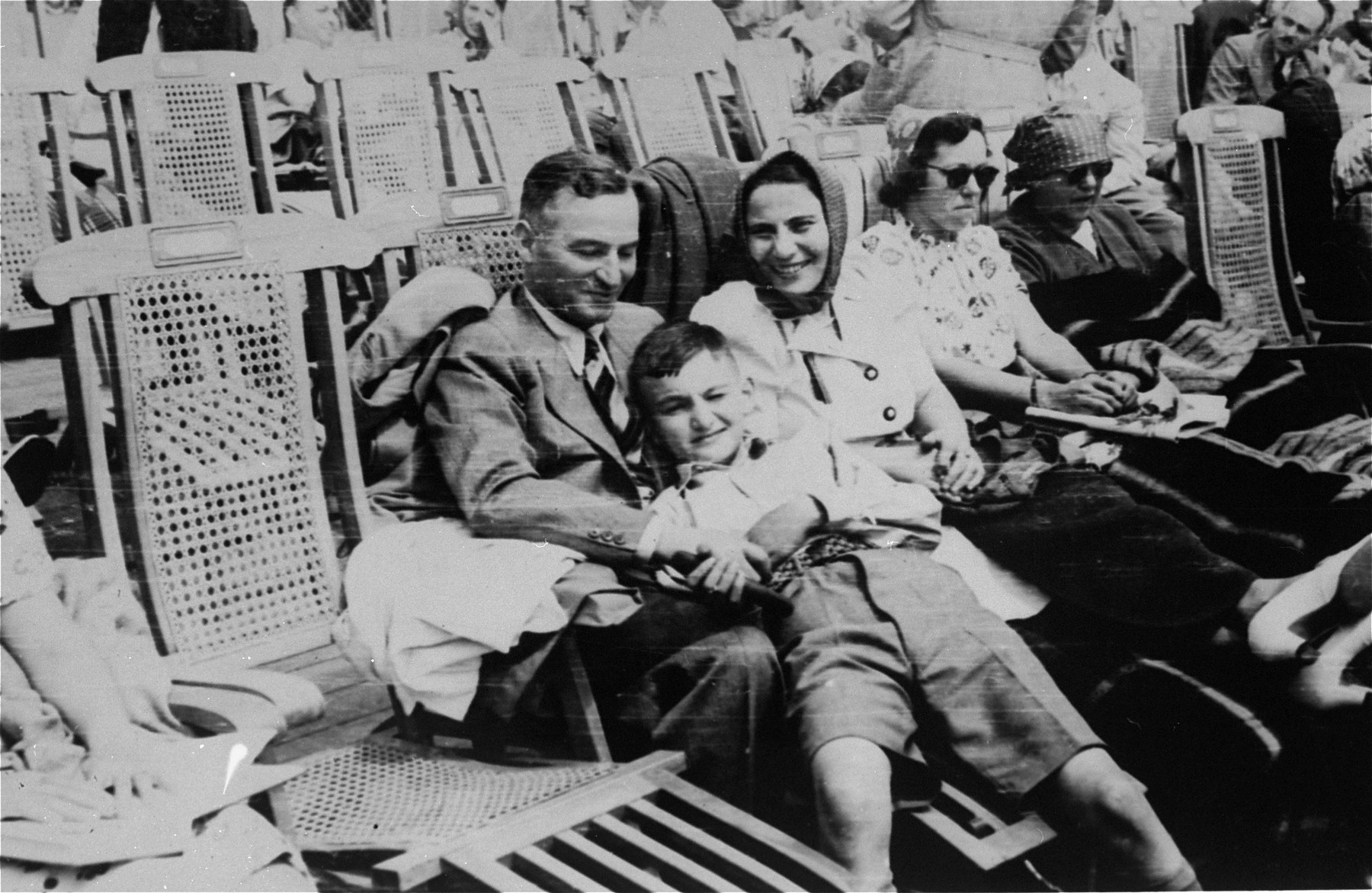 A Jewish refugee family from Germany poses on the deck of the SS Rotterdam while en route to New York.  Pictured are Sol and Henrietta Meyer and their son Harvey.  (The Meyers are the aunt and uncle of donor Jill Pauly.)