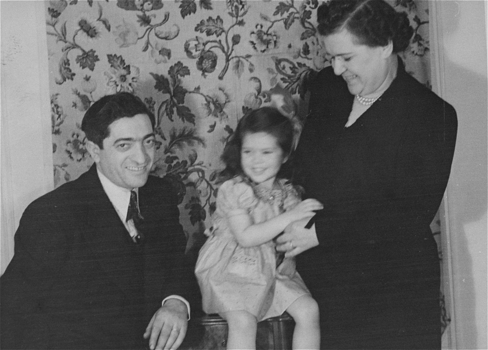 Portrait of the donor, Haviva, with her parents, Eliezer and Chaya Gar Kaplan, in their home in New York.