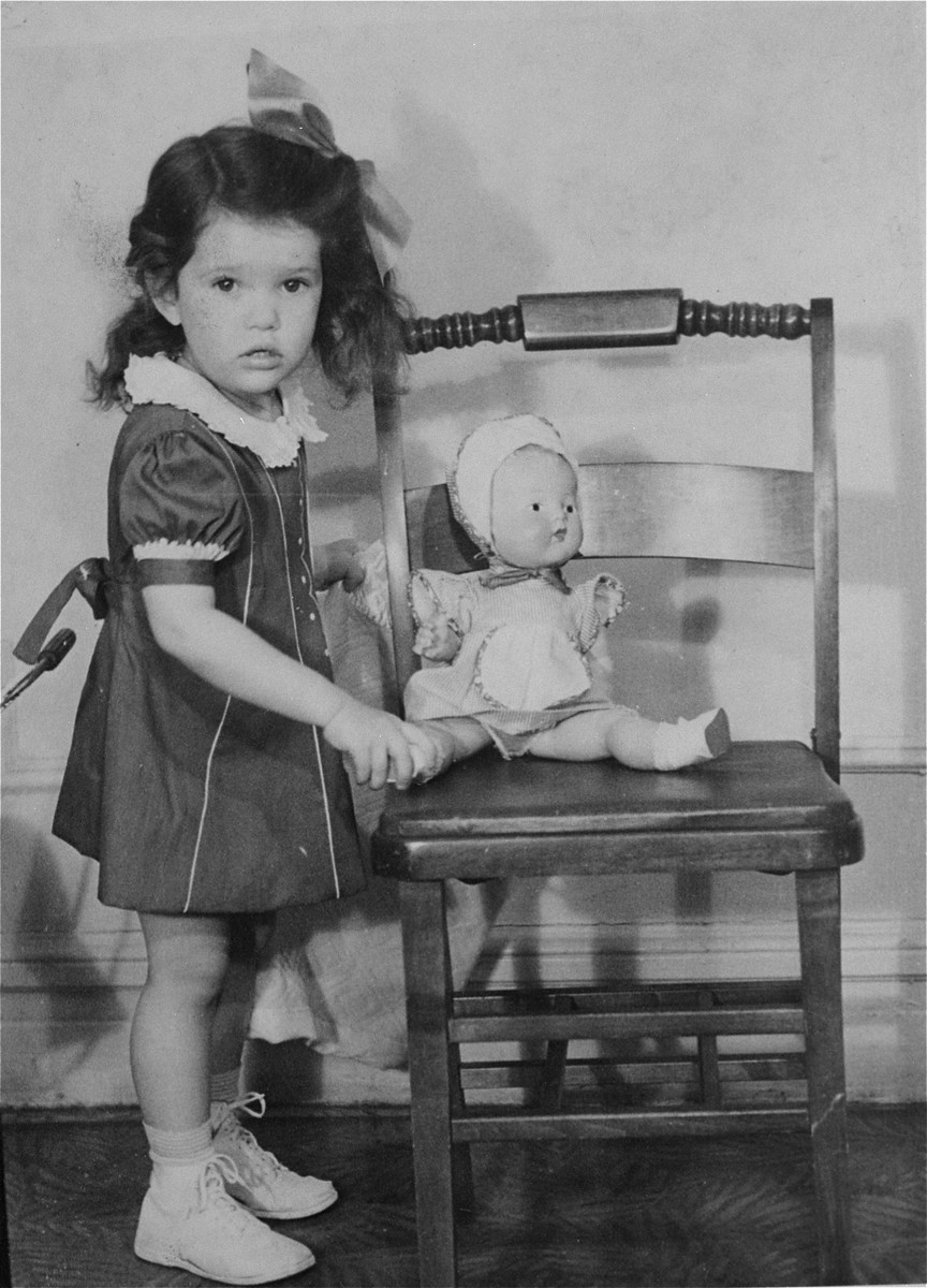 Portrait of the donor, Haviva Kaplan, with a doll in her home in New York.