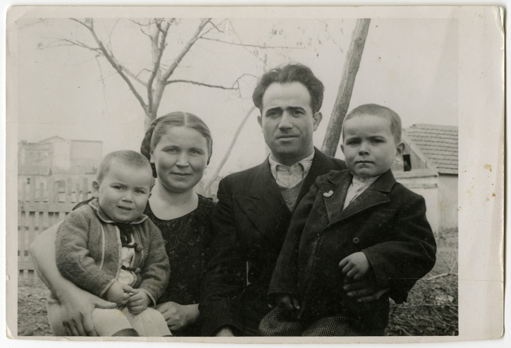 Group portrait of the Galicki family prior to their leaving the Soviet Union for Poland.  From left to right are Paul, Lydia, Noel and Albert.