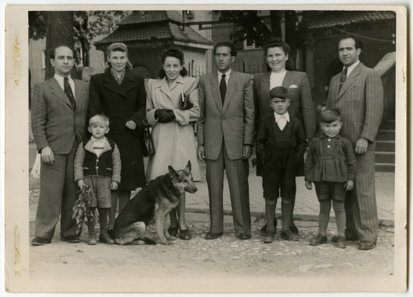Group portrait of the Galicki and Kolman families in the Ulm displaced persons camp.  From left to right Meyer Kolman , wife Vera Kolman, Lucia Galicki, Ben Galicki, Lydia Gell, Noel Gell Bottom Kolya Kolman   Albert Gell, Paul Gell.  Vera Kolman was from Uzbekistan and Mayer was from Poland. They later immigrated to Sao Paulo, Brazil.