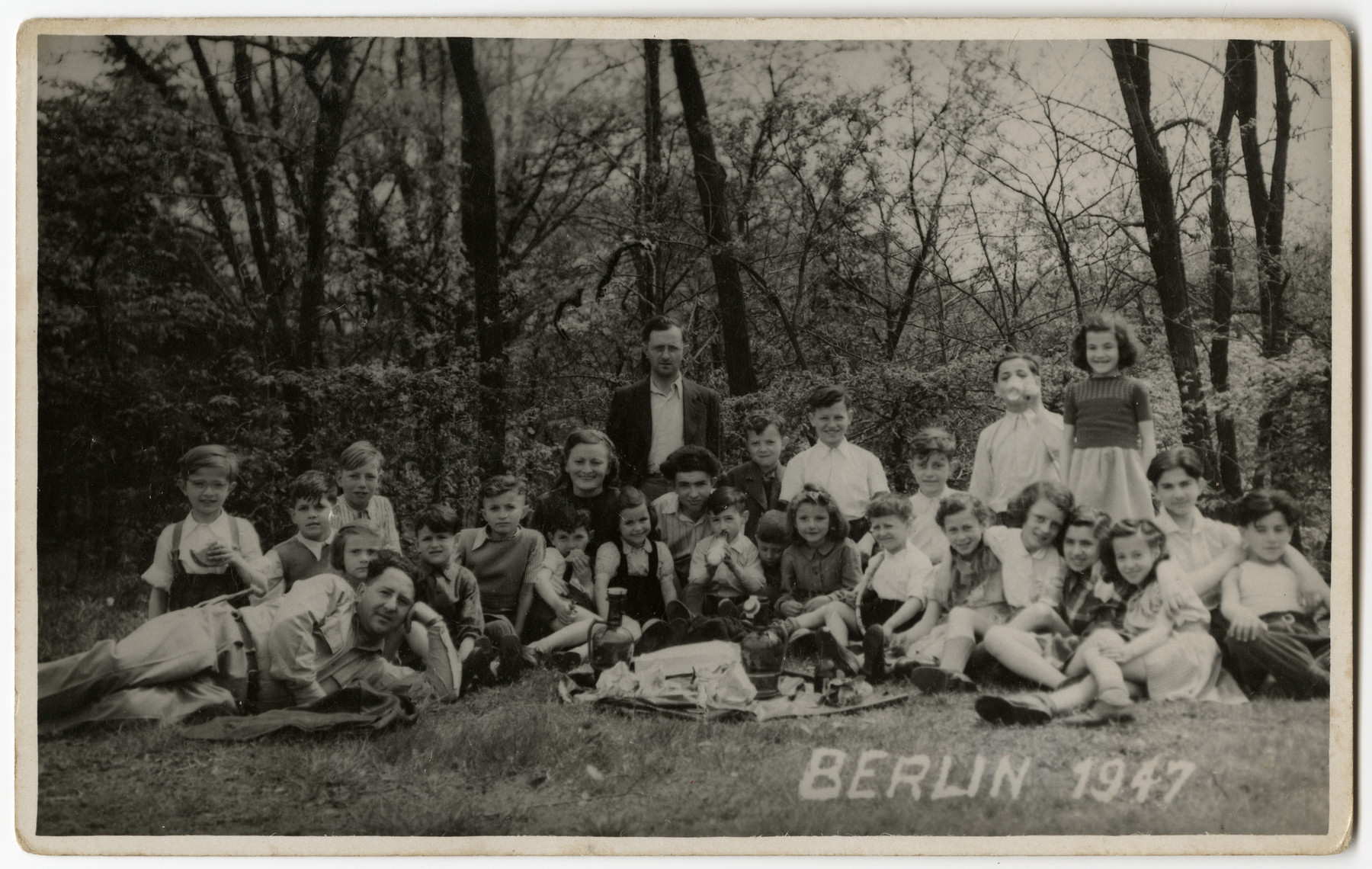 Group portrait of children and teachers from the Schlachtensee displaced persons camp.  Among those pictured is Benny Rubinstein.