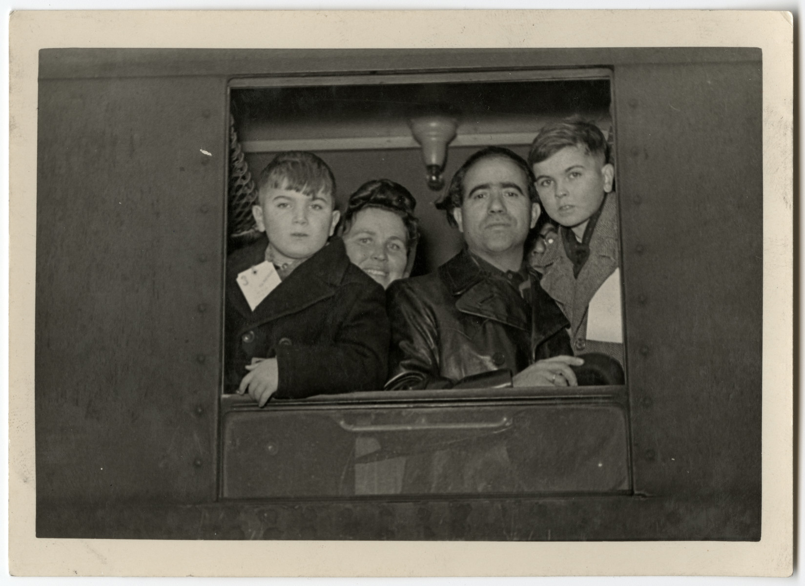The Galicki family looks out a train window as they leave for the Bremerhaven harbor en route to the United States.  From left to right are Paul, Lydia, Noel and Albert.
