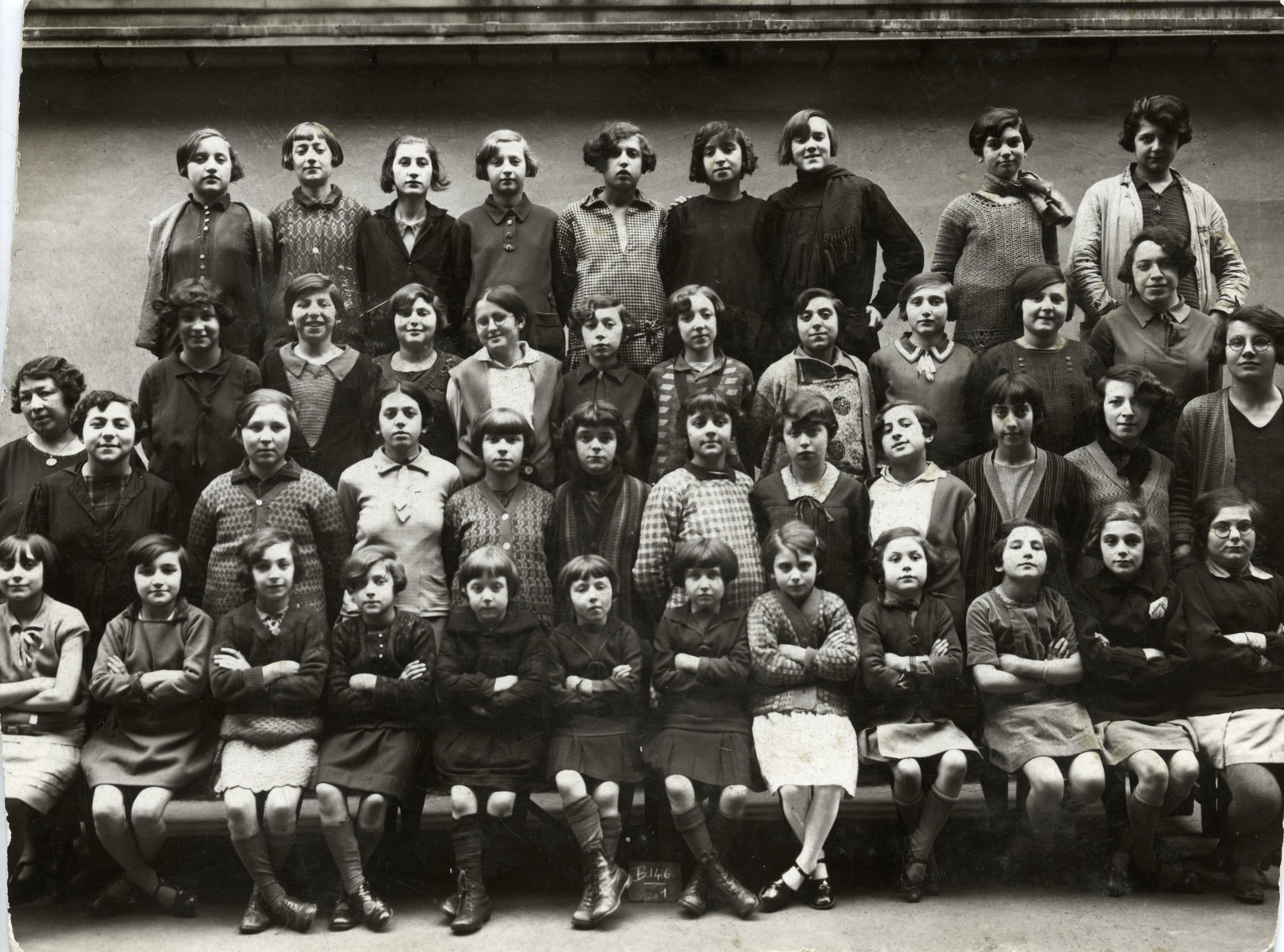 Group portrait of the girls in the Ecole Israelites, Hospitaliers St. Gervais, a school for Jewish refugees in Paris.  Miriam Einhorn is pictured in the top row, fifth from the left.