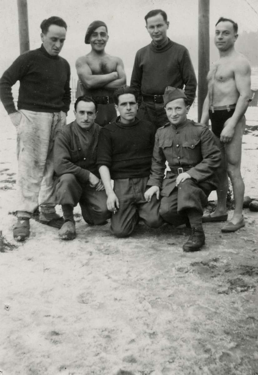 Group portrait of members of the French Foreign Legion in a prisoner of war camp in Germany.  Mendel Einhorn is pictured in uniform in the front row, right.